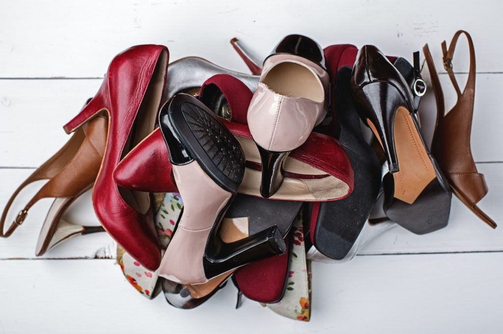 large pile of different women's fashion shoes